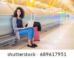 attractive woman at the airport ... | Shutterstock . vector #689617951