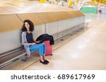 woman at the airport using... | Shutterstock . vector #689617969