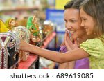 mother and daughter choosing... | Shutterstock . vector #689619085