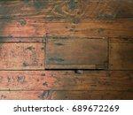 Small photo of Trap door in old wood plank floor