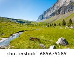beautiful green grass valley at ...   Shutterstock . vector #689679589