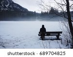 Sitting Alone On The Bench By...