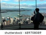 Small photo of AUCKLAND - AUG 03 2017:Visitor take photo with his mobile phone from Auckland's Sky Tower observation deck. In 2016 Auckland hosted a record total of 2.217 million international visitors.