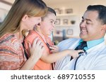 young boy and mother visiting... | Shutterstock . vector #689710555