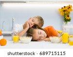 tired boy and girl fell asleep... | Shutterstock . vector #689715115
