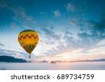 hot air balloon above mountains ... | Shutterstock . vector #689734759