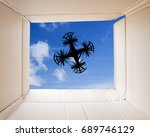 drone delivery seen through the ... | Shutterstock . vector #689746129