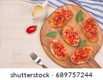 tasty italian bruschetta with ... | Shutterstock . vector #689757244