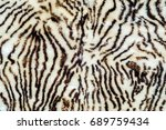 Small photo of Background, Texture. sheepskin, lambskin, sheep, budge. a sheep's skin with the wool on, especially when made into a garment or rug.