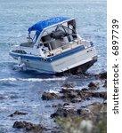motorboat crash on rocky shore | Shutterstock . vector #6897739