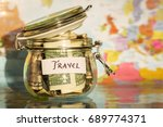 travel money savings in a glass ... | Shutterstock . vector #689774371