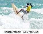 july 29  unidentified surfer in ... | Shutterstock . vector #689780965