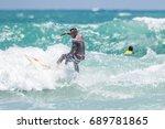 july 29  unidentified surfer in ...   Shutterstock . vector #689781865