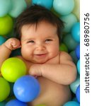 A Happy 3 Months Old Baby In A ...