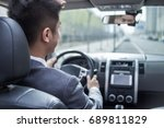 man driving car with navigation ... | Shutterstock . vector #689811829