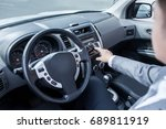 man driving car with navigation ... | Shutterstock . vector #689811919