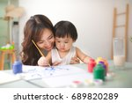 happy family mother and... | Shutterstock . vector #689820289