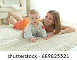 mom with the baby | Shutterstock . vector #689825521
