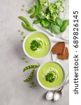 green pea soup in bowls on grey ... | Shutterstock . vector #689826145