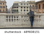 a tourist watching the piazza... | Shutterstock . vector #689838151