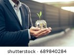 businessman cover growing plant ... | Shutterstock . vector #689840284