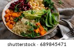 vegetarian buddha bowl with... | Shutterstock . vector #689845471