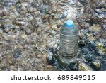 Small photo of Bottle of water on nature background. Save Nature, Save Water, Save the Earth, Save Life. Environmental concept.