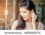pretty asian woman take a... | Shutterstock . vector #689864074