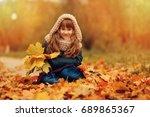 autumn outdoor portrait of... | Shutterstock . vector #689865367
