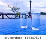 water glass on the table with...   Shutterstock . vector #689867875