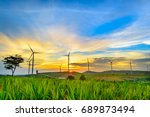 wind generators turbines at... | Shutterstock . vector #689873494