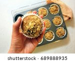 hand holding onto a muffins... | Shutterstock . vector #689888935