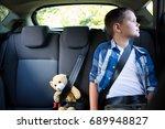 teenage boy sitting with teddy... | Shutterstock . vector #689948827