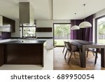 Small photo of Modern kitchen with steely furniture and nice view