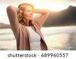 mature woman stretching with... | Shutterstock . vector #689960557