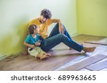 father and son installing new...   Shutterstock . vector #689963665