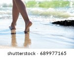 beach travel   woman walking | Shutterstock . vector #689977165