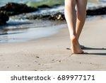 beach travel   woman walking | Shutterstock . vector #689977171
