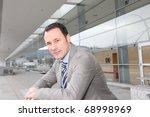 businessman standing outside...   Shutterstock . vector #68998969