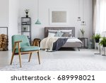 wooden mint armchair standing... | Shutterstock . vector #689998021