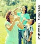 ordinary family of three... | Shutterstock . vector #690001339