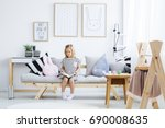 cute young girl reading book on ... | Shutterstock . vector #690008635