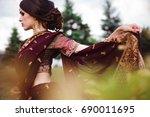 indian girl with oriental... | Shutterstock . vector #690011695