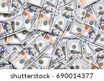 a pile of one hundred us... | Shutterstock . vector #690014377