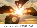 collaborate four hands trying... | Shutterstock . vector #690021061