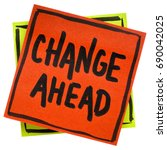 Small photo of change ahead warning, reminder or advice, - handwriting in black ink on an isolated sticky note