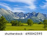 landscape in poland with tatras ... | Shutterstock . vector #690042595