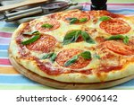 Margarita pizza with tomatoes cheese  and basil on the board - stock photo