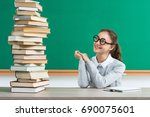 enthusiastic young pupil looks... | Shutterstock . vector #690075601