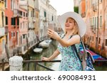 young female traveler making... | Shutterstock . vector #690084931